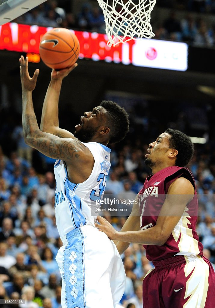 Reggie Bullock #35 of the North Carolina Tar Heels scores against Devon Bookert #1 of the Florida State Seminoles during play at Dean Smith Center on March 3, 2013 in Chapel Hill, North Carolina. North Carolina won 79-58.
