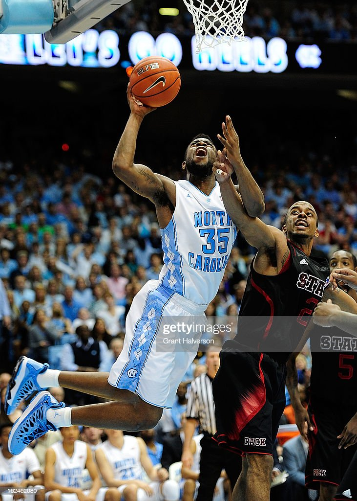 Reggie Bullock #35 of the North Carolina Tar Heels scores over Lorenzo Brown #2 of the North Carolina State Wolfpack during play at the Dean Smith Center on February 23, 2013 in Chapel Hill, North Carolina. North Carolina won 76-65.