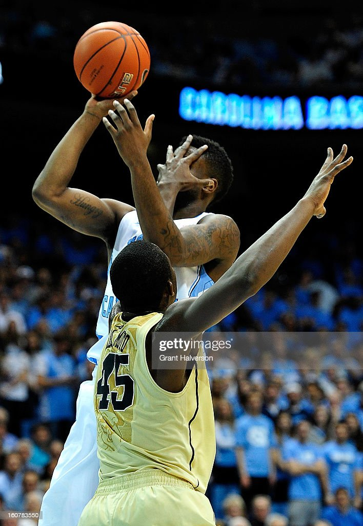 Reggie Bullock #35 of the North Carolina Tar Heels takes a hand to the face as he is fouled by Arnaud William Adala Moto #45 of the Wake Forest Demon Deacons during play at the Dean Smith Center on February 5, 2013 in Chapel Hill, North Carolina. North Carolina won 87-62.