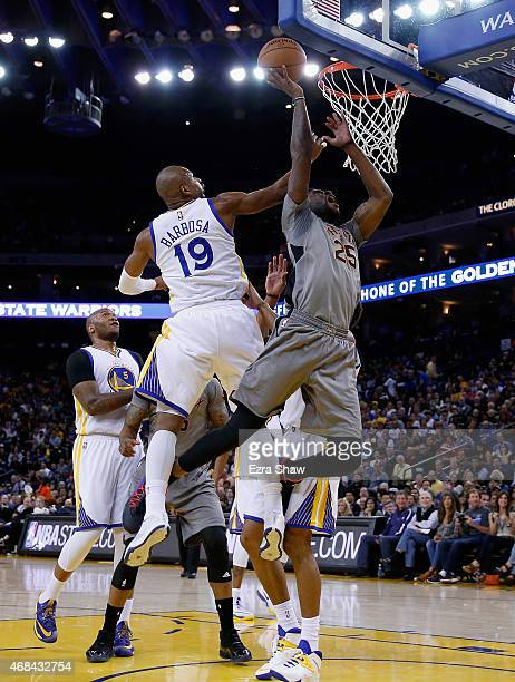 Reggie Bullock of the Phoenix Suns goes up for a shot against Leandro Barbosa of the Golden State Warriors at ORACLE Arena on April 2 2015 in Oakland...