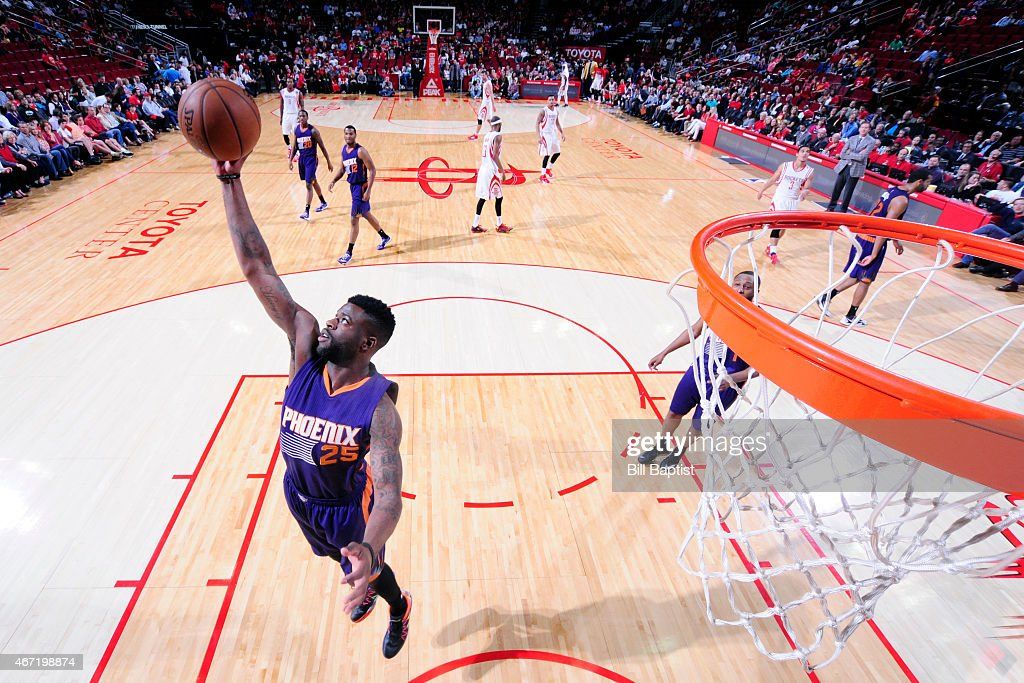<a gi-track='captionPersonalityLinkClicked' href=/galleries/search?phrase=Reggie+Bullock+-+Basketballer&family=editorial&specificpeople=10584530 ng-click='$event.stopPropagation()'>Reggie Bullock</a> #25 of the Phoenix Suns reaches for the ball against the Houston Rockets during the game on March 21, 2015 at Toyota Center in Houston, Texas.