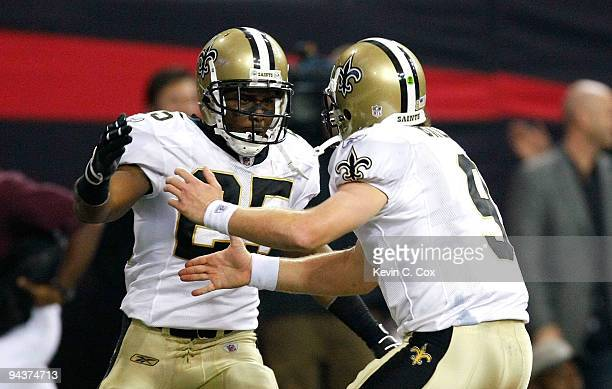 Reggie Bush and quarterback Drew Brees of the New Orleans Saints celebrate after they connected for a 6yard touchdown reception in the second quarter...