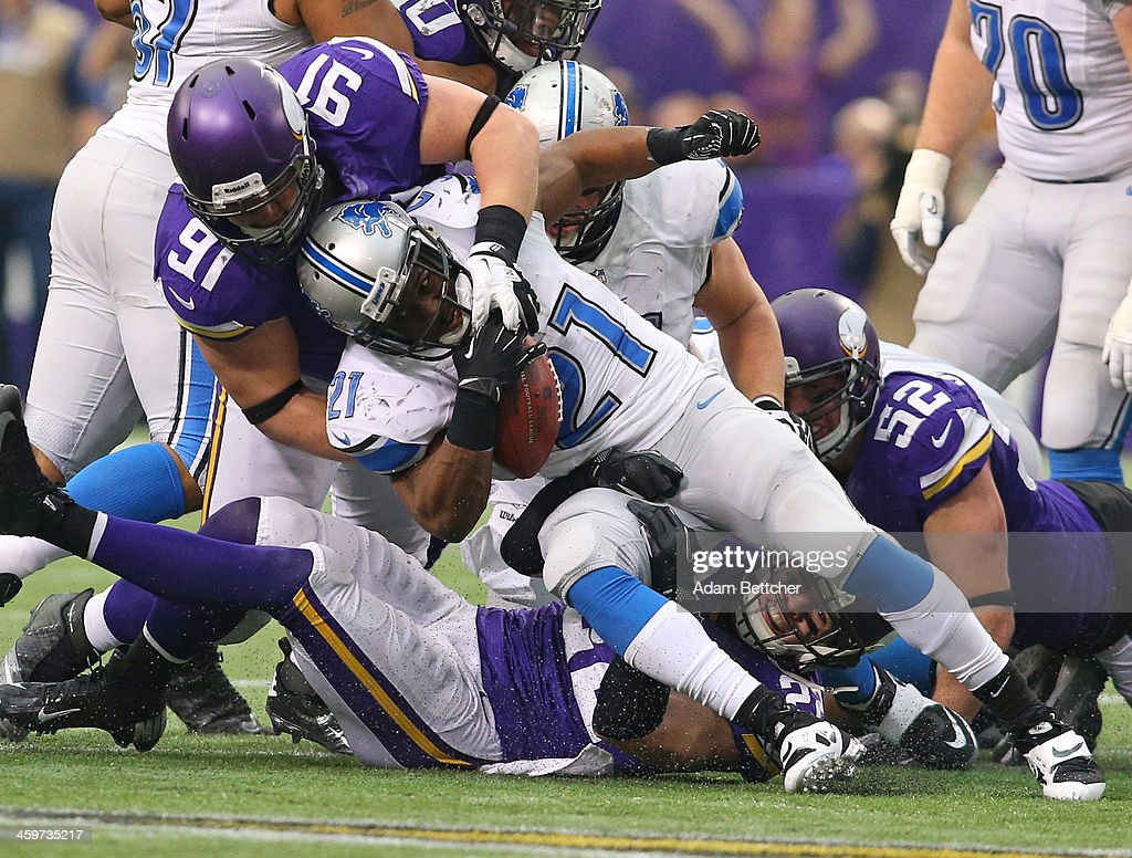 <a gi-track='captionPersonalityLinkClicked' href=/galleries/search?phrase=Reggie+Bush&family=editorial&specificpeople=183392 ng-click='$event.stopPropagation()'>Reggie Bush</a> #21 of the Detroit Lions gets tackled by <a gi-track='captionPersonalityLinkClicked' href=/galleries/search?phrase=Chase+Baker&family=editorial&specificpeople=2926867 ng-click='$event.stopPropagation()'>Chase Baker</a> #91 of the Minnesota Vikings on December 29, 2013 at Mall of America Field at the Hubert H. Humphrey Metrodome in Minneapolis, Minnesota.