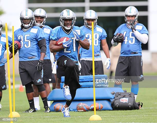 Reggie Bush of the Detroit Lions goes through the afternoon drills during training camp at the Detroit Lions training facility on July 28 2014 in...