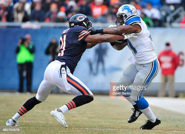 Reggie Bush of the Detroit Lions is tackled by Ryan Mundy of the Chicago Bears during the first half on December 21 2014 at Soldier Field in Chicago...