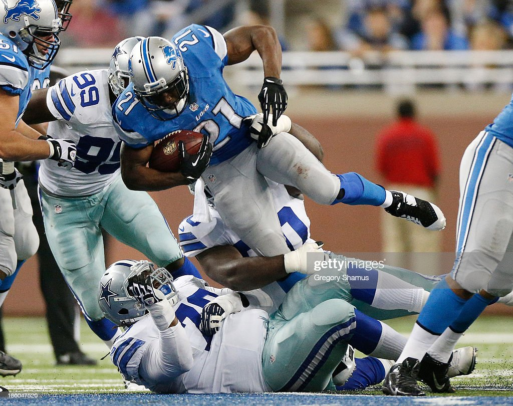 <a gi-track='captionPersonalityLinkClicked' href=/galleries/search?phrase=Reggie+Bush&family=editorial&specificpeople=183392 ng-click='$event.stopPropagation()'>Reggie Bush</a> #21 of the Detroit Lions jumps over <a gi-track='captionPersonalityLinkClicked' href=/galleries/search?phrase=Drake+Nevis&family=editorial&specificpeople=6348795 ng-click='$event.stopPropagation()'>Drake Nevis</a> #70 of the Dallas Cowboys for extra yards during a third quarter run at Ford Field on October 27, 2013 in Detroit, Michigan. Detroit won the game 31-30.
