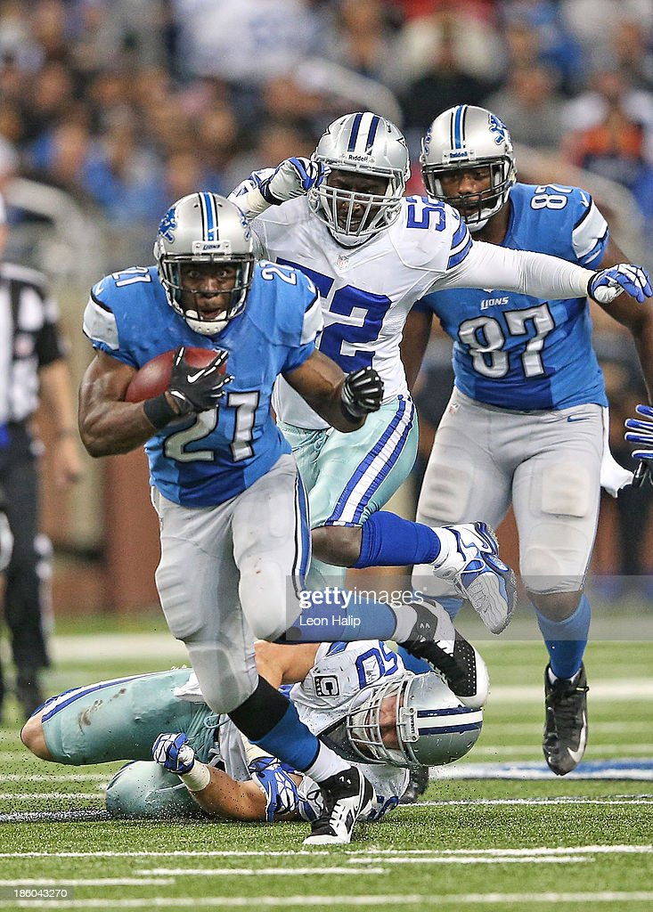 <a gi-track='captionPersonalityLinkClicked' href=/galleries/search?phrase=Reggie+Bush&family=editorial&specificpeople=183392 ng-click='$event.stopPropagation()'>Reggie Bush</a> #21 of the Detroit Lions runs for a first down during the third quarter of the game against the Dallas Cowboys at Ford Field on October 27, 2013 in Detroit, Michigan. The Lions defeated the Cowboys 31-30.