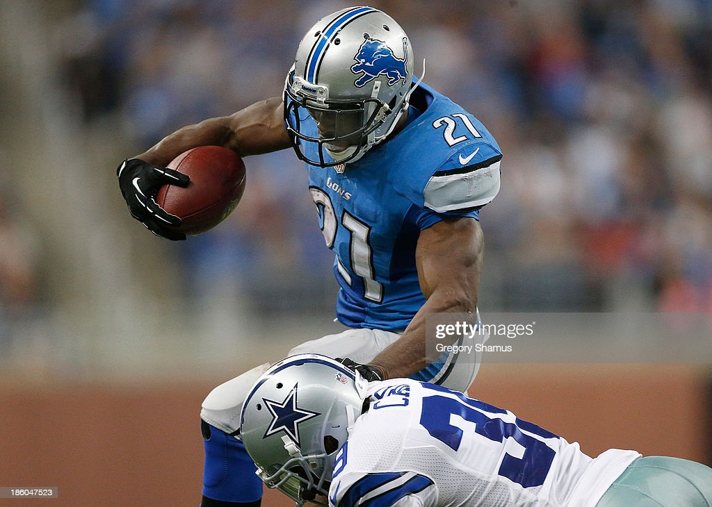 <a gi-track='captionPersonalityLinkClicked' href=/galleries/search?phrase=Reggie+Bush&family=editorial&specificpeople=183392 ng-click='$event.stopPropagation()'>Reggie Bush</a> #21 of the Detroit Lions tries to get around the tackle of <a gi-track='captionPersonalityLinkClicked' href=/galleries/search?phrase=Brandon+Carr&family=editorial&specificpeople=5357381 ng-click='$event.stopPropagation()'>Brandon Carr</a> #39 of the Dallas Cowboys during a fourth quarter run at Ford Field on October 27, 2013 in Detroit, Michigan. Detroit won the game 31-30.