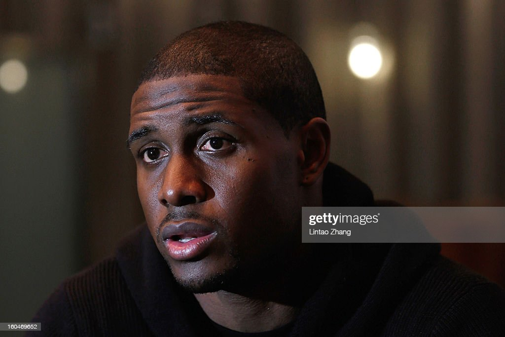 <a gi-track='captionPersonalityLinkClicked' href=/galleries/search?phrase=Reggie+Bush&family=editorial&specificpeople=183392 ng-click='$event.stopPropagation()'>Reggie Bush</a> of the Miami Dolphins answers media questions at Kerry Hotel on February 1, 2013 in Beijing, China.