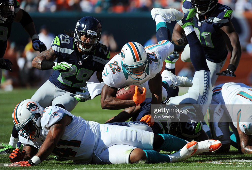 Reggie Bush of the Miami Dolphins dives for extra yardage against the Seattle Seahawks in the 2nd quarter at Sun Life Stadium in Miami Gardens, Florida, Sunday, November 25, 2012. The Miami Dolphins beat the Seattle Seahawks, 24-21.