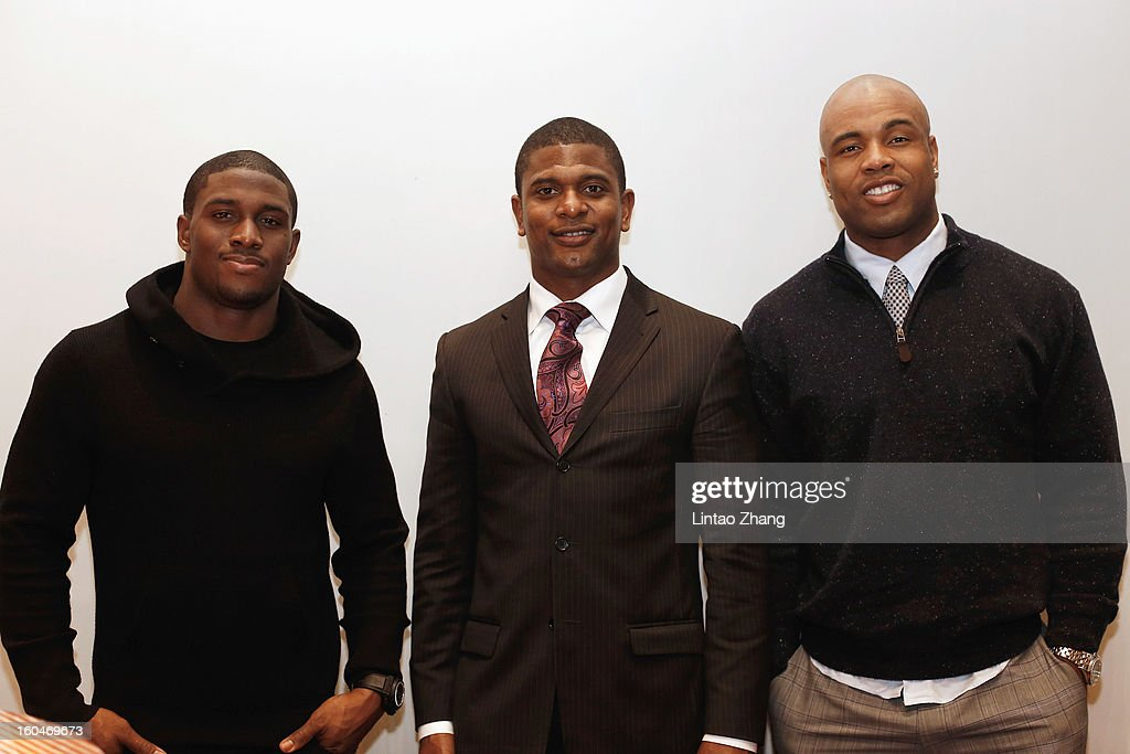 Reggie Bush of the Miami Dolphins, Jack Brewer and former NFL player Akin Ayodele pose for the photo during the media day at Kerry Hotel on February 1, 2013 in Beijing, China.
