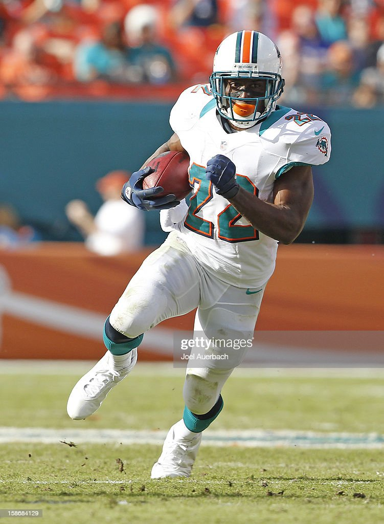 <a gi-track='captionPersonalityLinkClicked' href=/galleries/search?phrase=Reggie+Bush&family=editorial&specificpeople=183392 ng-click='$event.stopPropagation()'>Reggie Bush</a> #22 of the Miami Dolphins runs with the ball against the Buffalo Bills on December 23, 2012 at Sun Life Stadium in Miami Gardens, Florida. The Dolphins defeated the Bills 24-10.