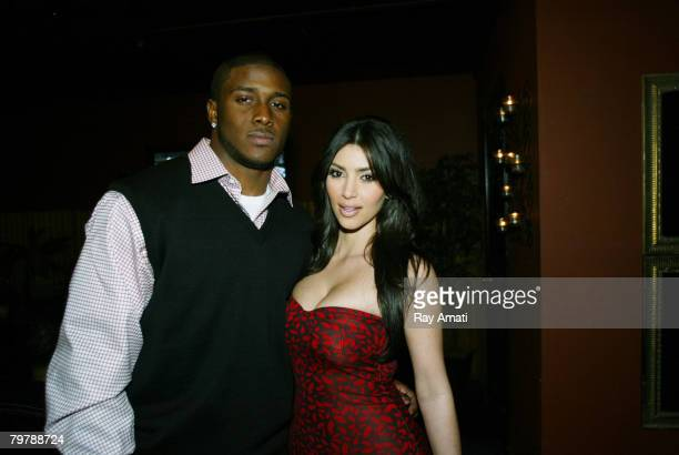 Reggie Bush of the New Orleans Saints and actress Kim Kardashian pose during the EA Sports NBA Live AllStar Challenge at Republic on February 14 2008...