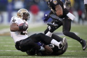 Reggie Bush of the New Orleans Saints is tackled during a play against the Baltimore Ravenson December 19 2010 at MT Bank Stadium in Baltimore...