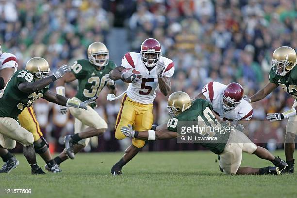 Reggie Bush of the USC Trojans breaks free for a 3rd quarter touchdown against the Notre Dame Irish at Notre Dame Stadium in South Bend Indiana on...