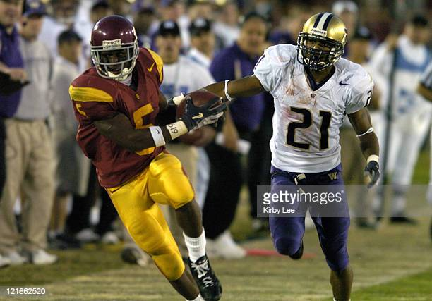 Reggie Bush of USC catches a pass in front of Washington cornerback Derrick Johnson in the fourth quarter of 380 victory in Pacific10 Conference...