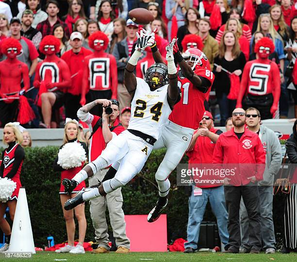 Reggie Davis of the Georgia Bulldogs makes a catch against Dante Blackmon of the Appalachian State Mountaineers at Sanford Stadium on November 9 2013...