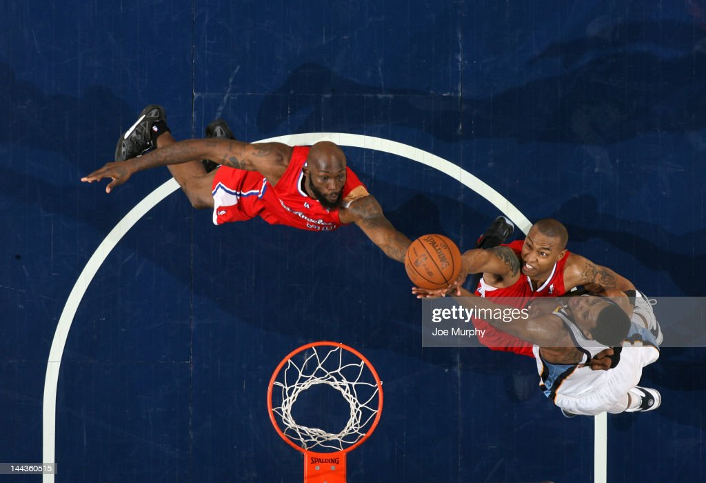 Reggie Evans #30 and Caron Butler #5 of the Los Angeles Clippers reach for the rebound against Rudy Gay #22 of the Memphis Grizzlies in Game Seven of the Western Conference Quarterfinals during the 2012 NBA Playoffs on May 13, 2012 at FedExForum in Memphis, Tennessee.
