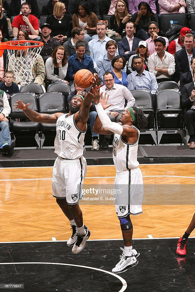 Reggie Evans #30 and Gerald Wallace #45 of the Brooklyn Nets go up for a rebound against the Chicago Bulls on April 4, 2013 at the Barclays Center in the Brooklyn borough of New York City.