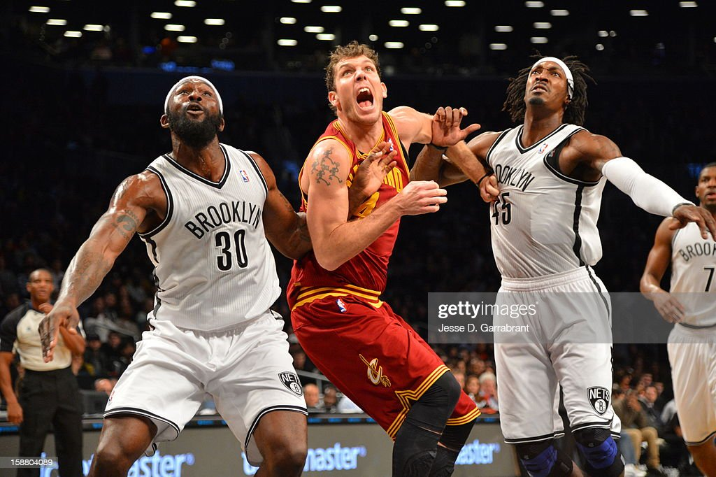 Reggie Evans #30 and Gerald Williams #45 of the Brooklyn Nets battles for postioning against Luke Walton #4 of the Cleveland Cavaliers during the game at the Barclays Center on December 29, 2012 in Brooklyn, New York.