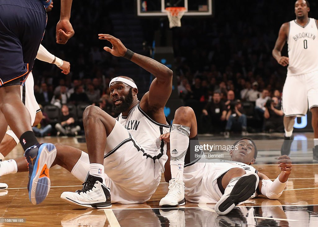 Reggie Evans #30 and MarShon Brooks #9 of the Brooklyn Nets collide in the second half of the game against the Barclays Center on December 28, 2012 in the Brooklyn borough of New York City.
