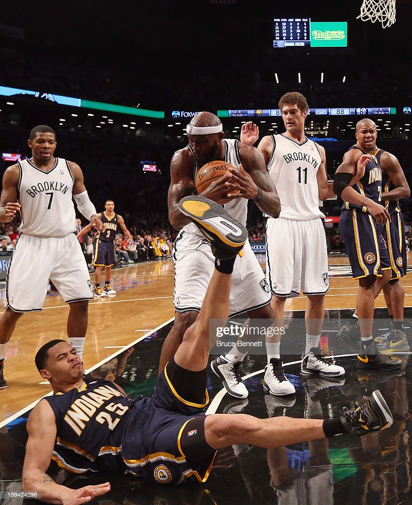 Reggie Evans #30 of the Brooklyn Nets and Gerald Green #25 of the Indiana Pacers battle over a loose ball in the fourth quarter at the Barclays Center on January 13, 2013 in New York City.