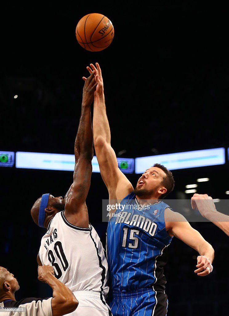 Reggie Evans #30 of the Brooklyn Nets and Hedo Turkoglu #15 of the Orlando Magic battle during a jump ball during their game at the Barclays Center on January 28, 2013 in the Brooklyn borough of New York City.
