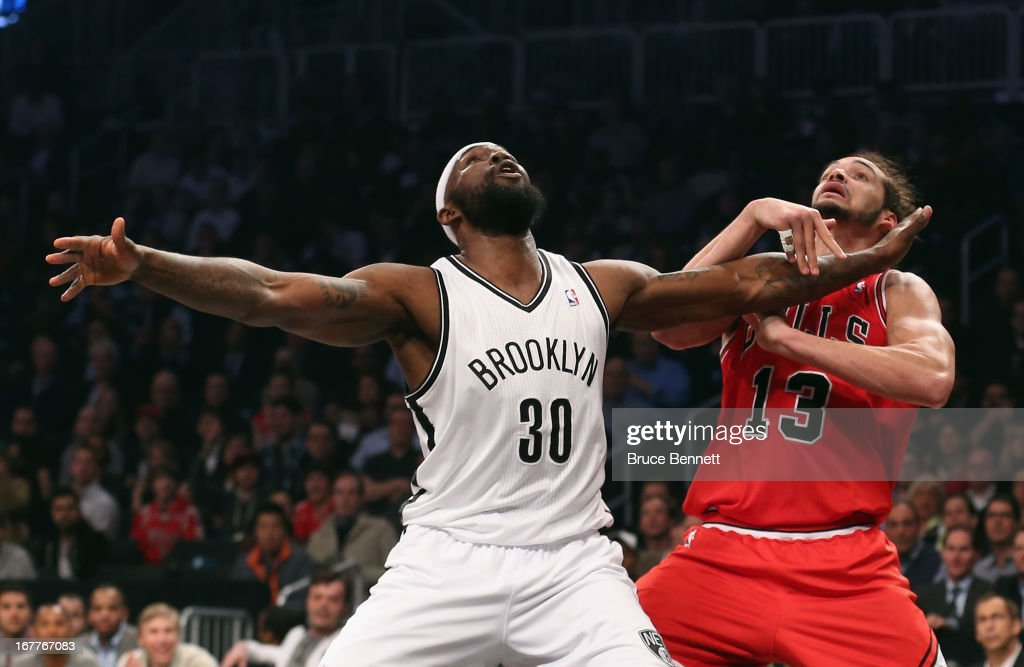 Reggie Evans #30 of the Brooklyn Nets and Joakim Noah #13 of the Chicago Bulls battle for a rebound during Game Five of the Eastern Conference Quarterfinals of the 2013 NBA Playoffs at the Barclays Center on April 29, 2013 in New York City.