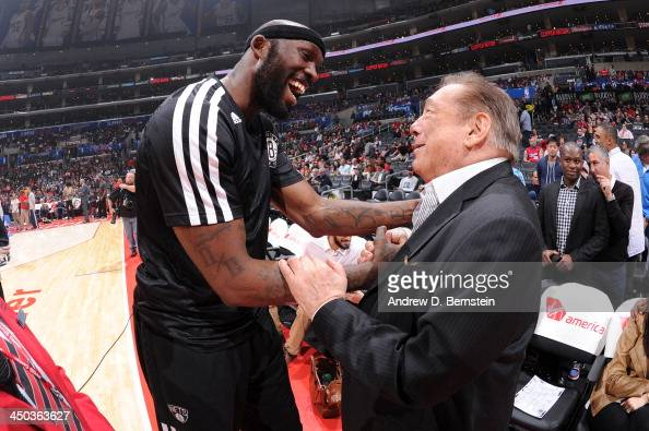 Reggie Evans of the Brooklyn Nets and Los Angeles Clippers Owner Donald Sterling converse before a game on November 16 2013 at STAPLES Center in Los...