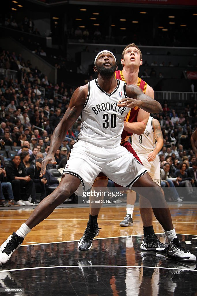 <a gi-track='captionPersonalityLinkClicked' href=/galleries/search?phrase=Reggie+Evans&family=editorial&specificpeople=202254 ng-click='$event.stopPropagation()'>Reggie Evans</a> #30 of the Brooklyn Nets awaits a rebound against the Cleveland Cavaliers on November 13, 2012 at the Barclays Center in the Brooklyn Borough of New York City.
