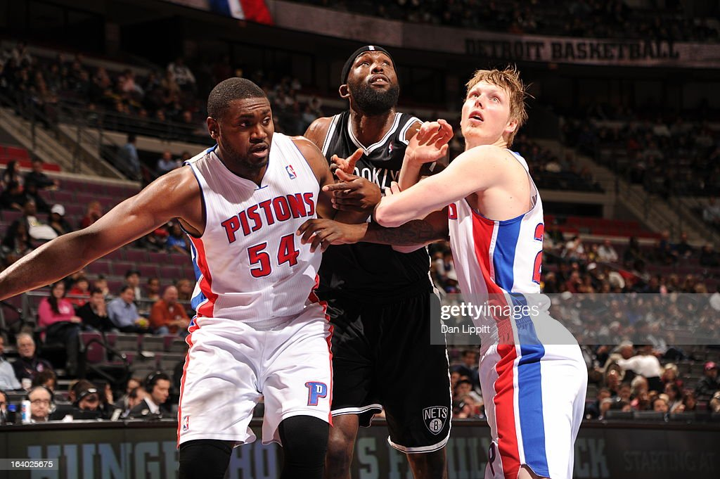 Reggie Evans #30 of the Brooklyn Nets battles for positioning against Jason Maxiell #54 and Kyle Singler #25 of the Detroit Pistons on March 18, 2013 at The Palace of Auburn Hills in Auburn Hills, Michigan.