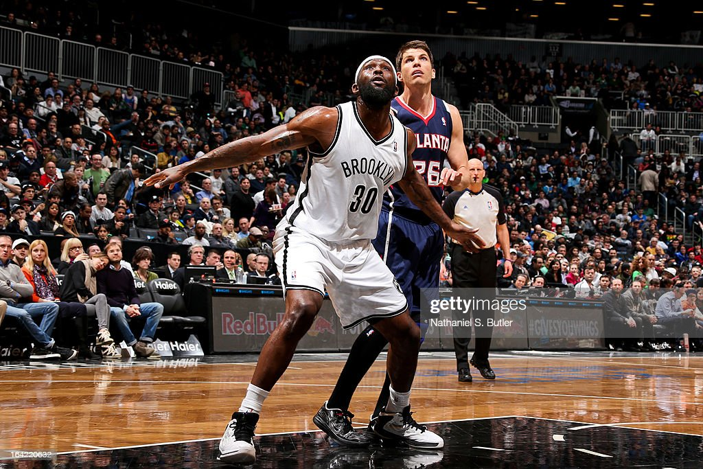 Reggie Evans #30 of the Brooklyn Nets battles for rebound position against Kyle Korver #26 of the Atlanta Hawks on March 17, 2013 at the Barclays Center in the Brooklyn borough of New York City.