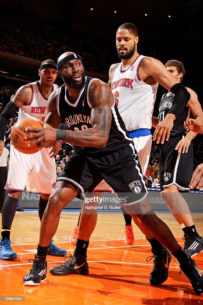 Reggie Evans #30 of the Brooklyn Nets controls the ball against Tyson Chandler #6 of the New York Knicks January 21, 2013 at Madison Square Garden in New York City.