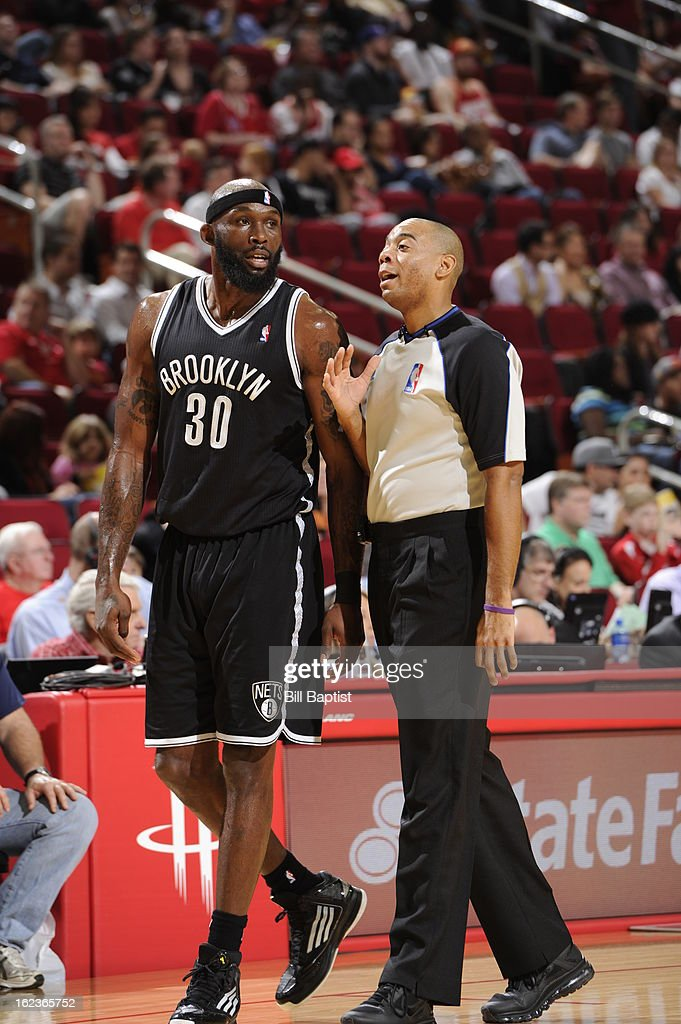 <a gi-track='captionPersonalityLinkClicked' href=/galleries/search?phrase=Reggie+Evans&family=editorial&specificpeople=202254 ng-click='$event.stopPropagation()'>Reggie Evans</a> #30 of the Brooklyn Nets discusses a play with an official in the game against the Houston Rockets on January 26, 2013 at the Toyota Center in Houston, Texas.