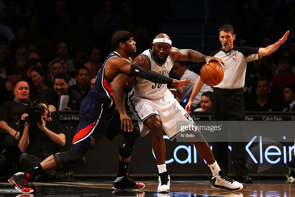 Reggie Evans #30 of the Brooklyn Nets drives against Josh Smith #5 of the Atlanta Hawks in the first quarter of the game at Barclays Center on January 18, 2013 in the Brooklyn borough of New York City.