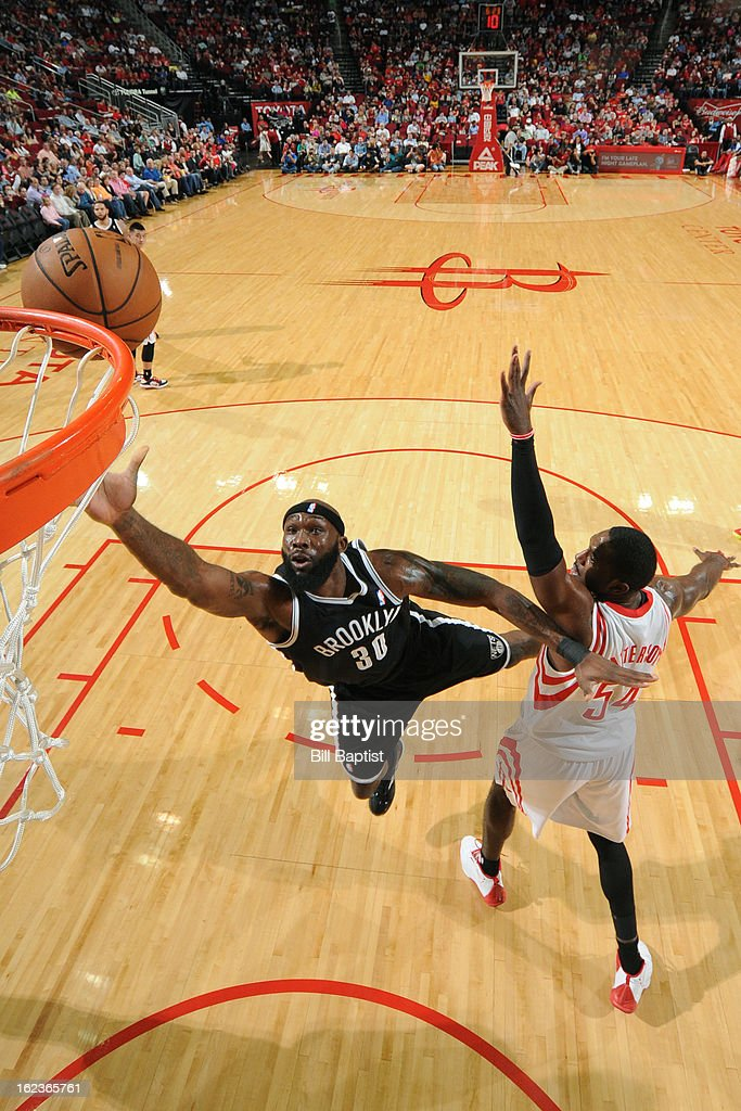 <a gi-track='captionPersonalityLinkClicked' href=/galleries/search?phrase=Reggie+Evans&family=editorial&specificpeople=202254 ng-click='$event.stopPropagation()'>Reggie Evans</a> #30 of the Brooklyn Nets drives to the basket against the Houston Rockets on January 26, 2013 at the Toyota Center in Houston, Texas.