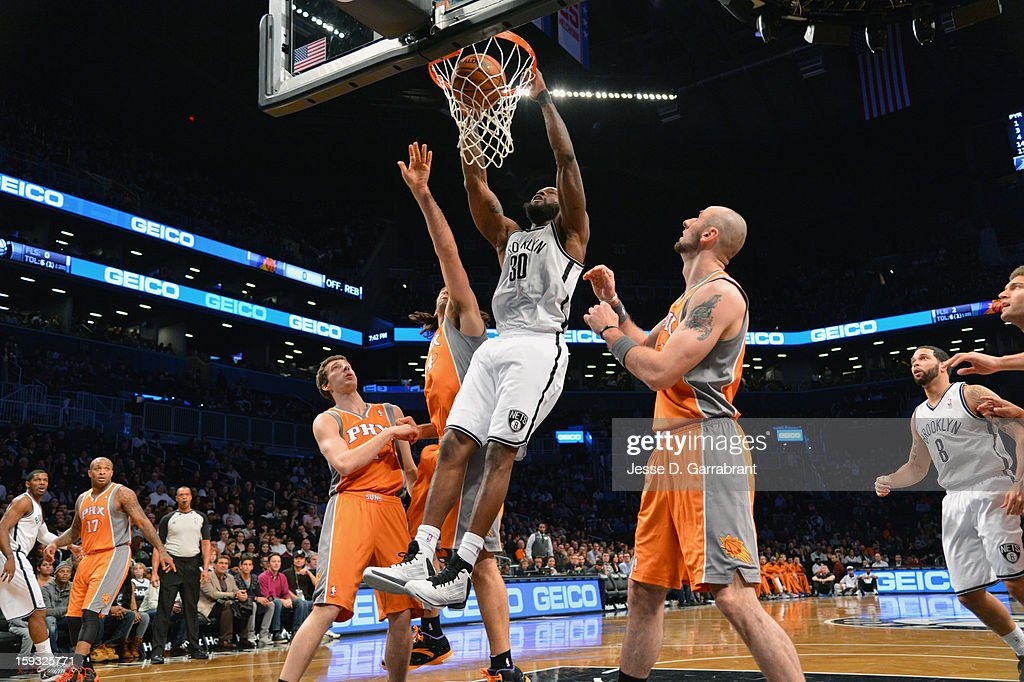 Reggie Evans #30 of the Brooklyn Nets dunks against the Phoenix Suns during the game at the Barclays Center on January 11, 2013 in Brooklyn, New York.