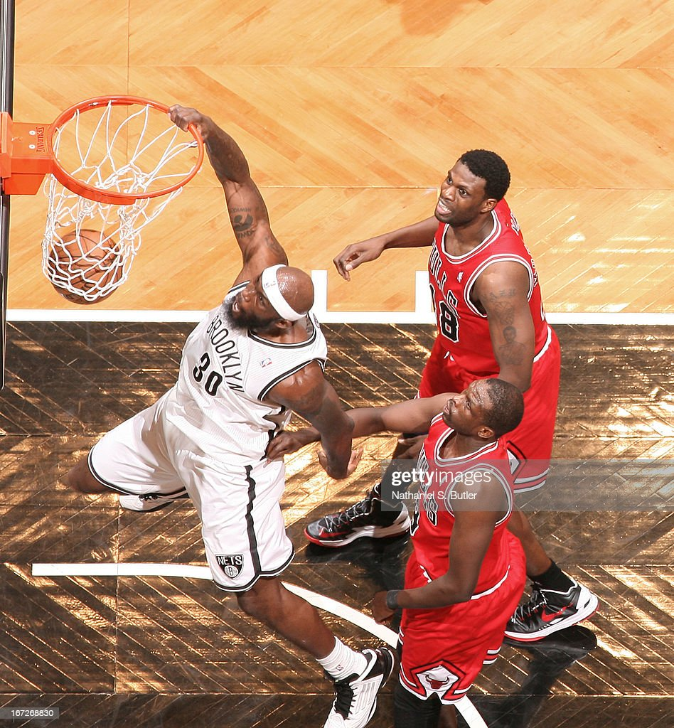 <a gi-track='captionPersonalityLinkClicked' href=/galleries/search?phrase=Reggie+Evans&family=editorial&specificpeople=202254 ng-click='$event.stopPropagation()'>Reggie Evans</a> #30 of the Brooklyn Nets dunks the ball against the Chicago Bulls in Game Two of the Eastern Conference Quarterfinals during the 2013 NBA Playoffs on April 22 at the Barclays Center in the Brooklyn borough of New York City.