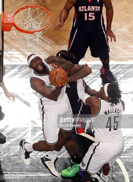 Reggie Evans of the Brooklyn Nets goes up for a basket in the first half against the Atlanta Hawks at the Barclays Center on March 17 2013 in New...