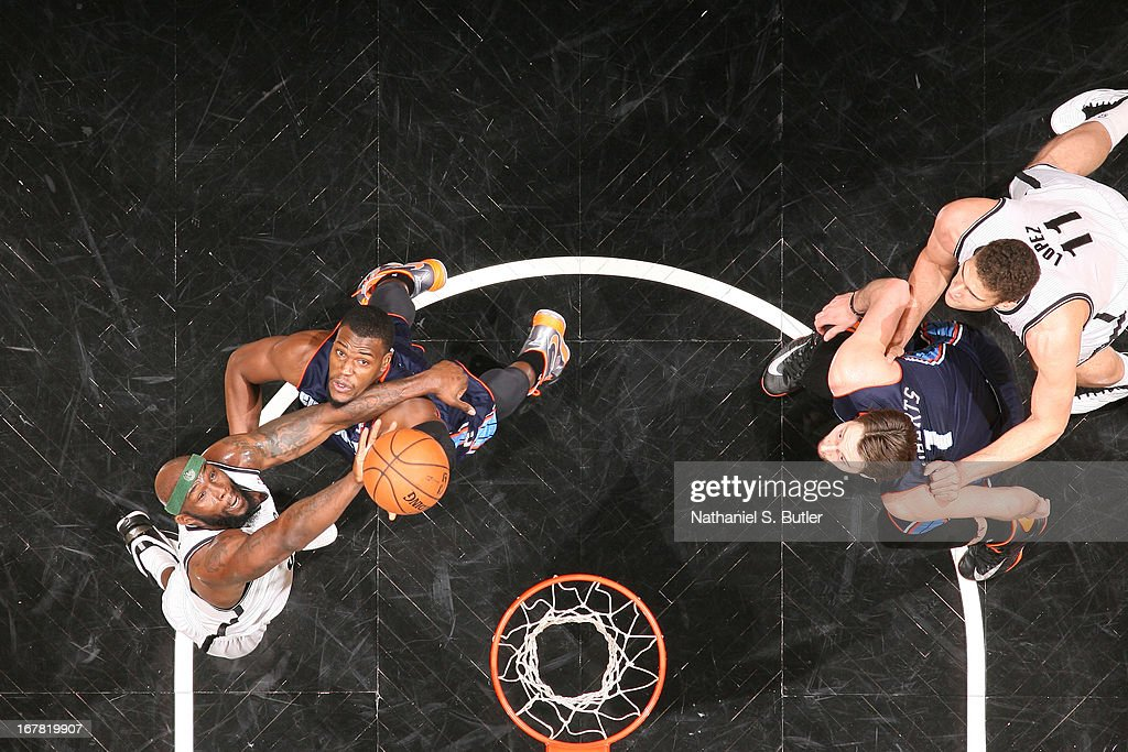 Reggie Evans #30 of the Brooklyn Nets goes up for a rebound against Jeff Adrien #4 of the Charlotte Bobcats on April 6, 2013 at the Barclays Center in the Brooklyn borough of New York City.