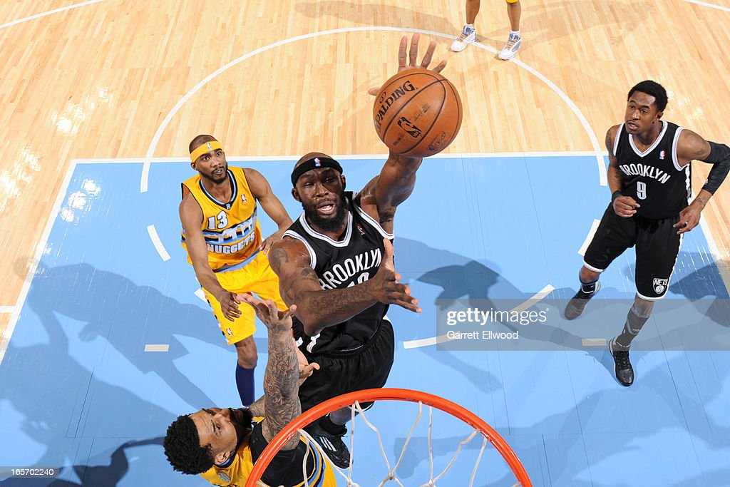 <a gi-track='captionPersonalityLinkClicked' href=/galleries/search?phrase=Reggie+Evans&family=editorial&specificpeople=202254 ng-click='$event.stopPropagation()'>Reggie Evans</a> #30 of the Brooklyn Nets goes up for a rebound against the Denver Nuggets on March 29, 2013 at the Pepsi Center in Denver, Colorado.