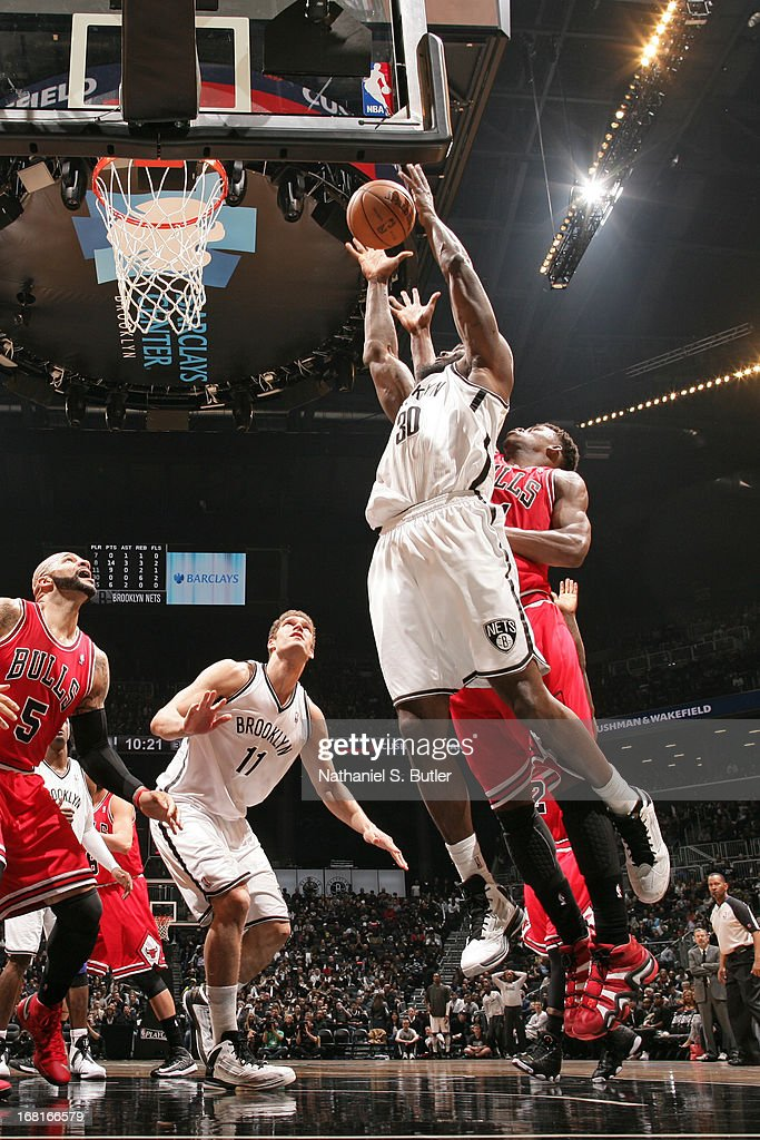 Reggie Evans #30 of the Brooklyn Nets goes up for a rebound against the Chicago Bulls during the Game Seven of the Eastern Conference Quarterfinals during the 2013 NBA Playoffs at the Barclays Center on May 4, 2013 in the Brooklyn borough of New York City.