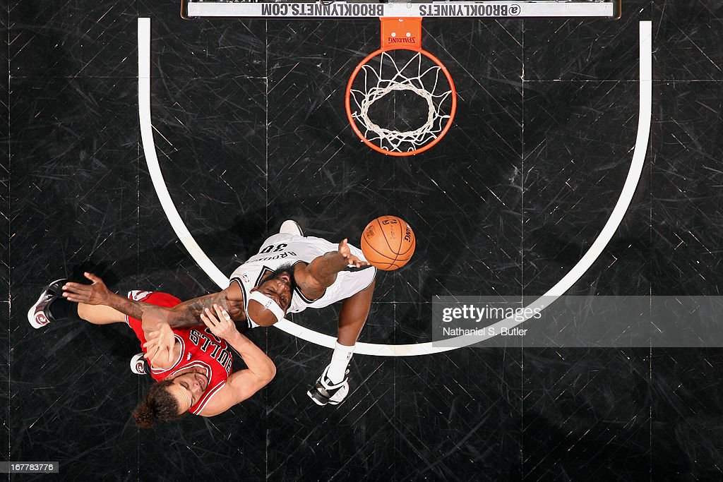 Reggie Evans #30 of the Brooklyn Nets goes up for the shot against Joakim Noah #13 of the Chicago Bulls in Game Five of the Eastern Conference Quarterfinals during the 2013 NBA Playoffs on April 29 at the Barclays Center in the Brooklyn borough of New York City.