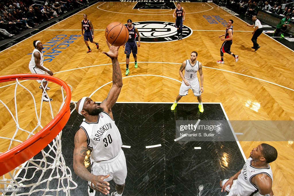 Reggie Evans #30 of the Brooklyn Nets grabs a rebound against the Atlanta Hawks on March 17, 2013 at the Barclays Center in the Brooklyn borough of New York City.