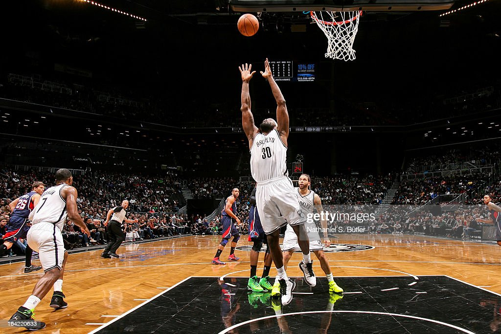 <a gi-track='captionPersonalityLinkClicked' href=/galleries/search?phrase=Reggie+Evans&family=editorial&specificpeople=202254 ng-click='$event.stopPropagation()'>Reggie Evans</a> #30 of the Brooklyn Nets grabs a rebound against the Atlanta Hawks on March 17, 2013 at the Barclays Center in the Brooklyn borough of New York City.