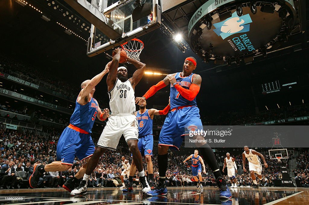 Reggie Evans #30 of the Brooklyn Nets grabs a rebound against the New York Knicks on December 11, 2012 at the Barclays Center in the Brooklyn borough of New York City.