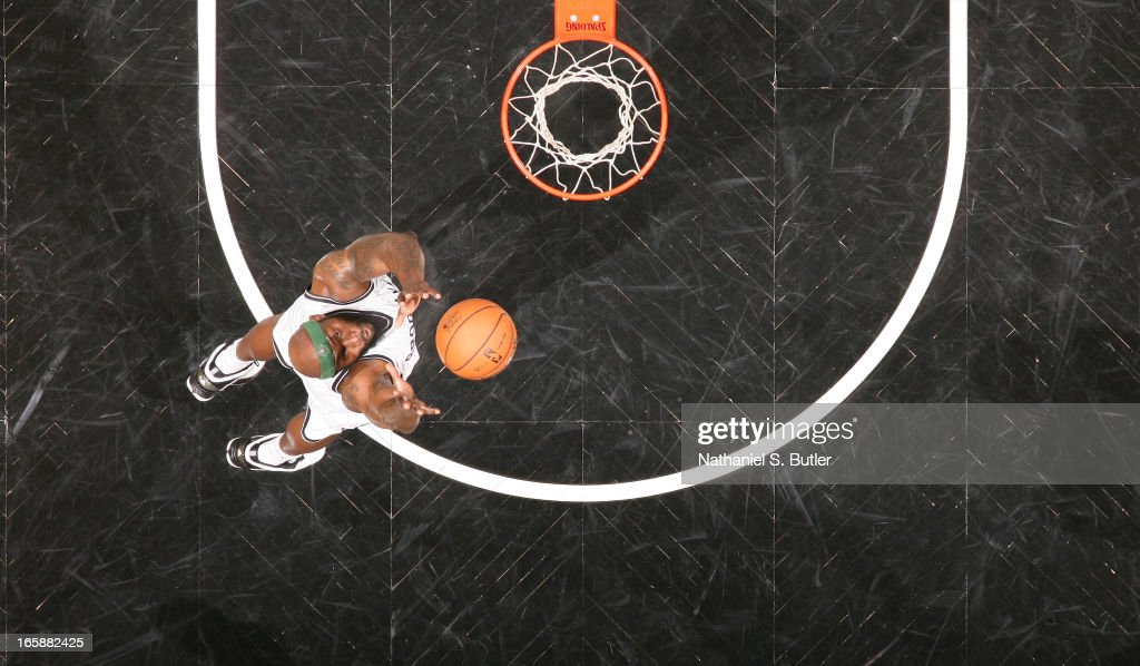 <a gi-track='captionPersonalityLinkClicked' href=/galleries/search?phrase=Reggie+Evans&family=editorial&specificpeople=202254 ng-click='$event.stopPropagation()'>Reggie Evans</a> #30 of the Brooklyn Nets grabs a rebound against the Charlotte Bobcats on April 6, 2013 at the Barclays Center in the Brooklyn borough of New York City.