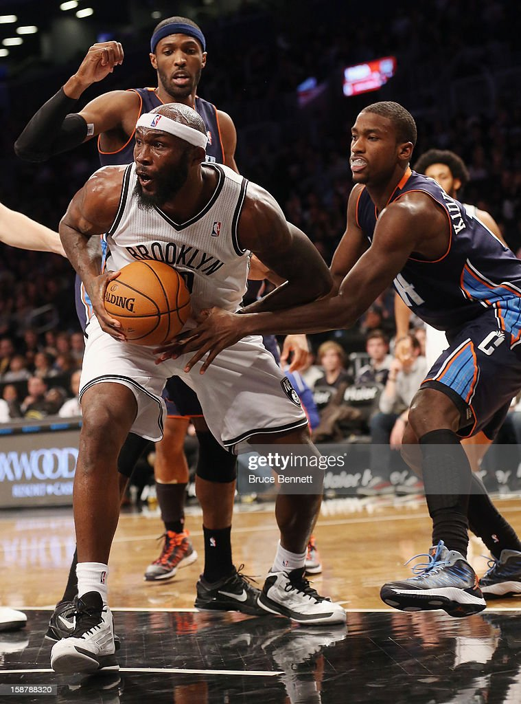 Reggie Evans #30 of the Brooklyn Nets holds the ball as Michael Kidd-Gilchrist #14 of the Charlotte Bobcats tries to get it at the Barclays Center on December 28, 2012 in the Brooklyn borough of New York City.