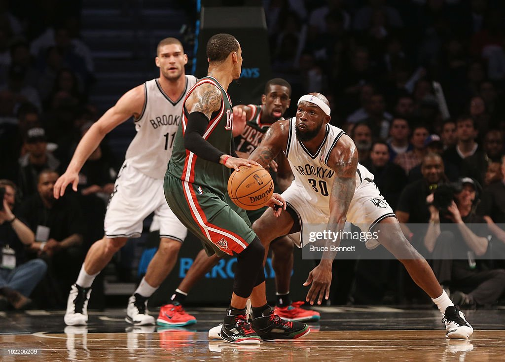 <a gi-track='captionPersonalityLinkClicked' href=/galleries/search?phrase=Reggie+Evans&family=editorial&specificpeople=202254 ng-click='$event.stopPropagation()'>Reggie Evans</a> #30 of the Brooklyn Nets plays defense against the Milwaukee Bucks at the Barclays Center on February 19, 2013 in New York City.
