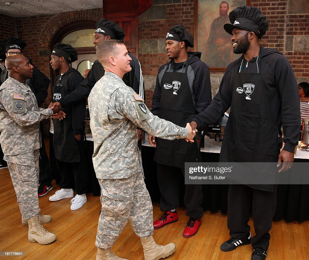 Reggie Evans #30 of the Brooklyn Nets poses for a picture during a team event in celebration of Veterans Day at Ft. Hamilton, Brooklyn on November 11, 2013 in the Brooklyn borough of New York City.
